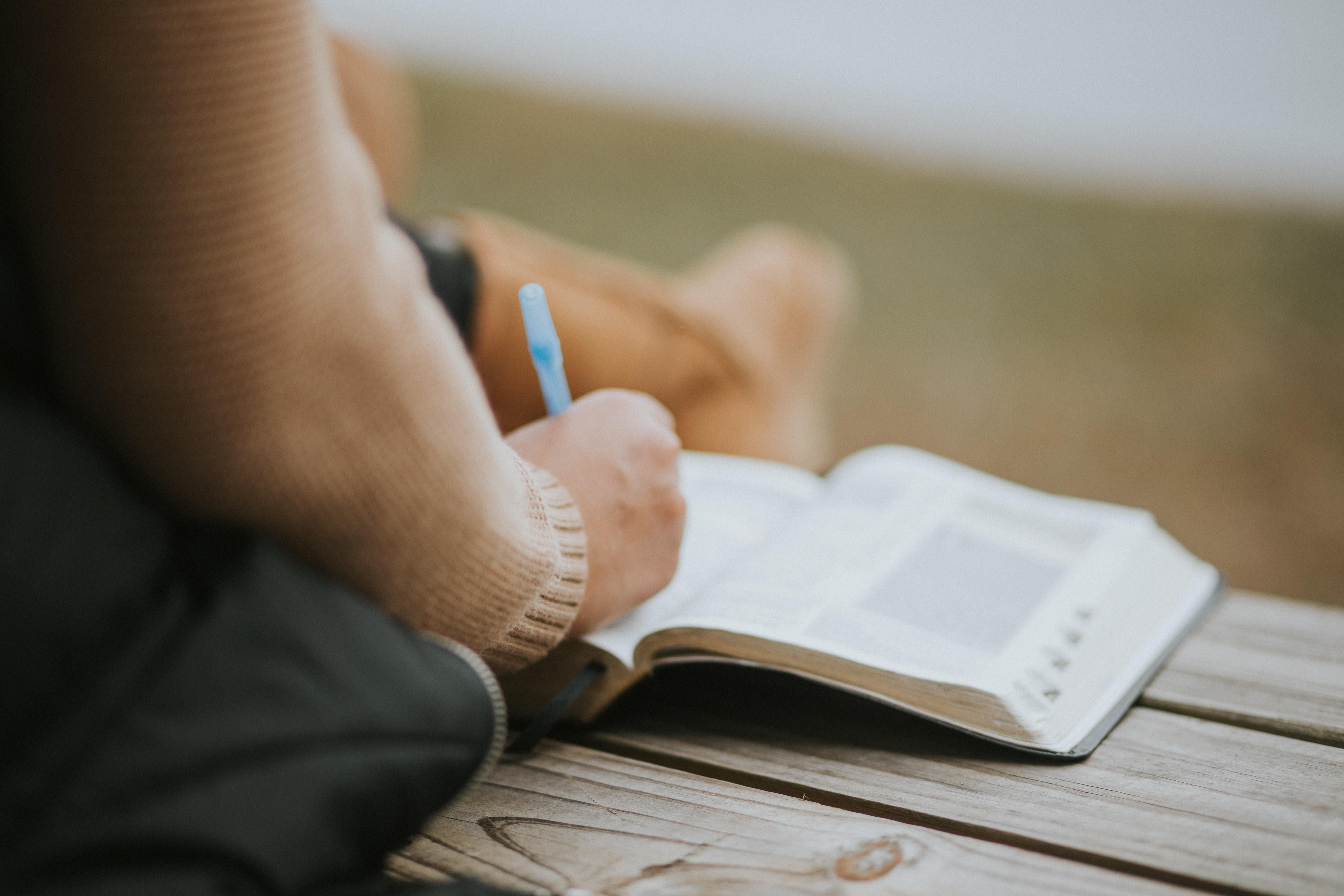 woman annotating bible