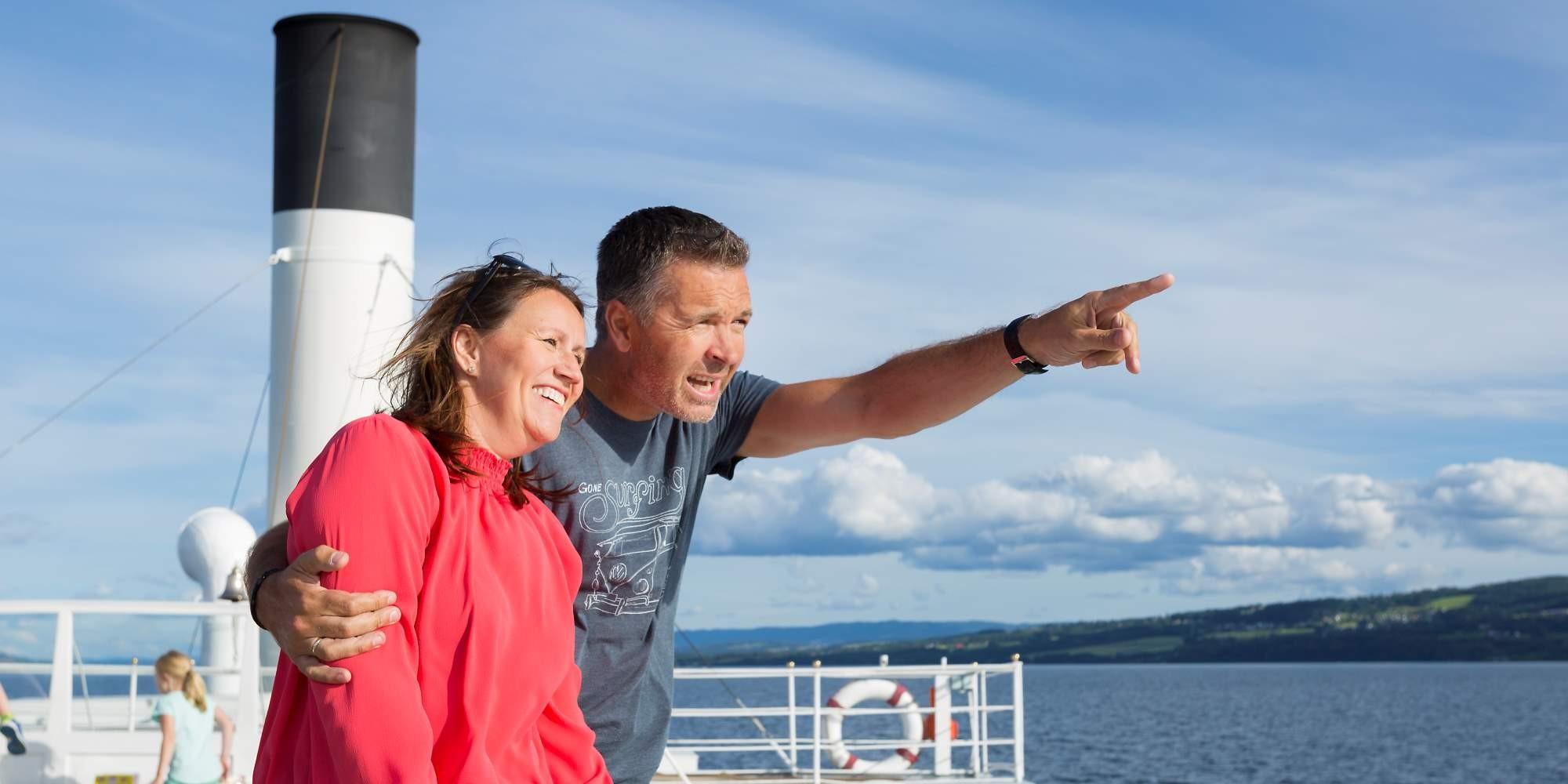 Couple exploring lake Mjøsa with Skibladner Paddle Steamer