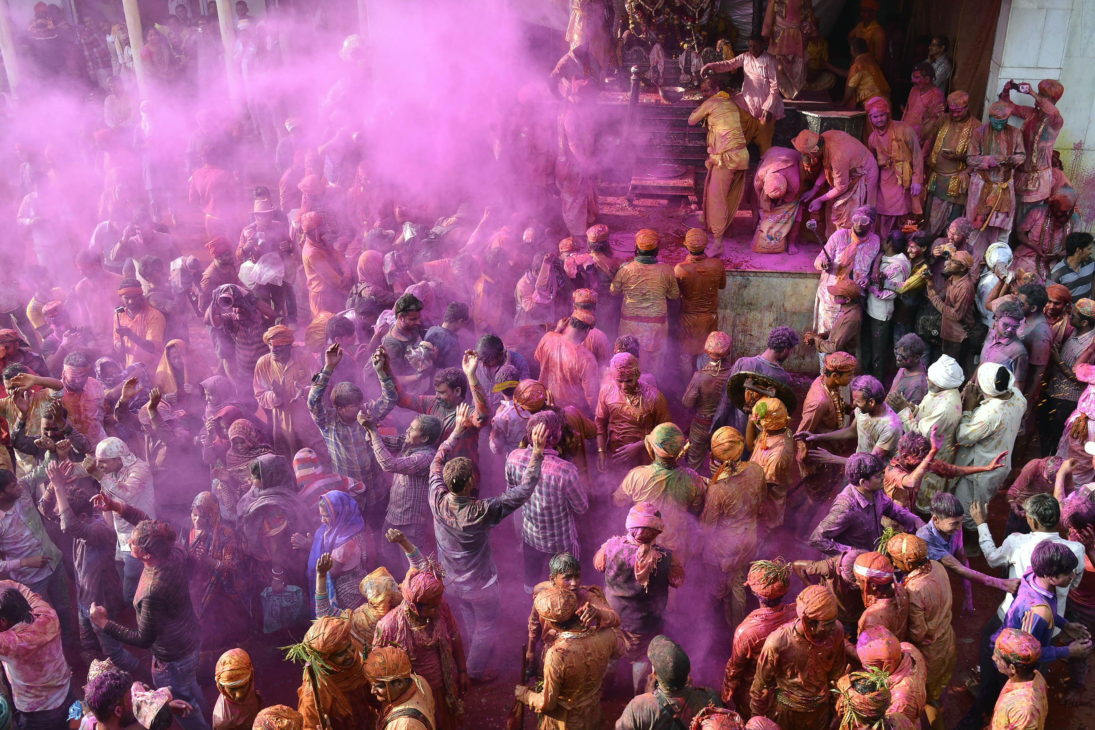 Indian Hindu devotees celebrate Holi the spring festival of colours during a traditional gathering