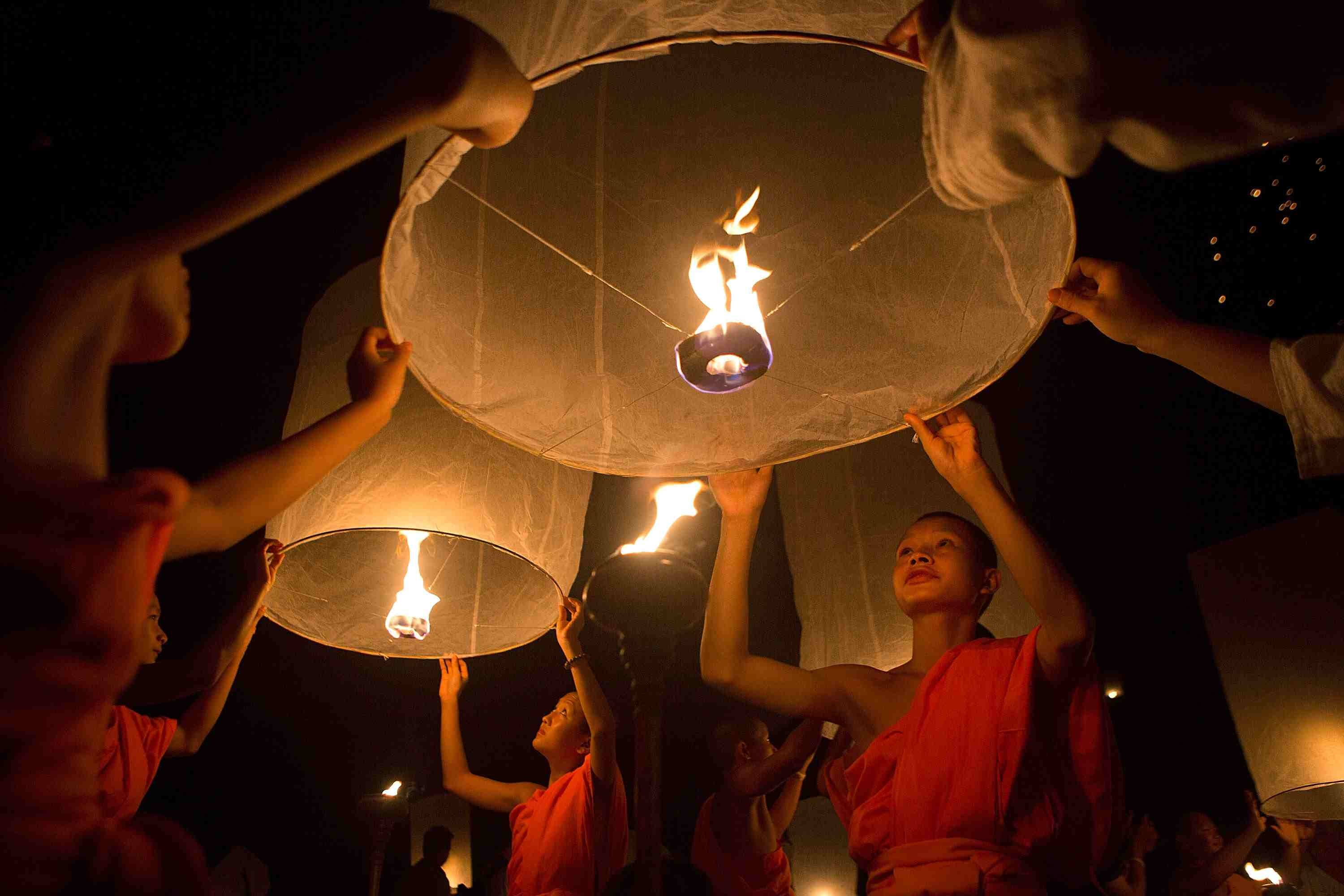 Buddhist Monks With Lanterns