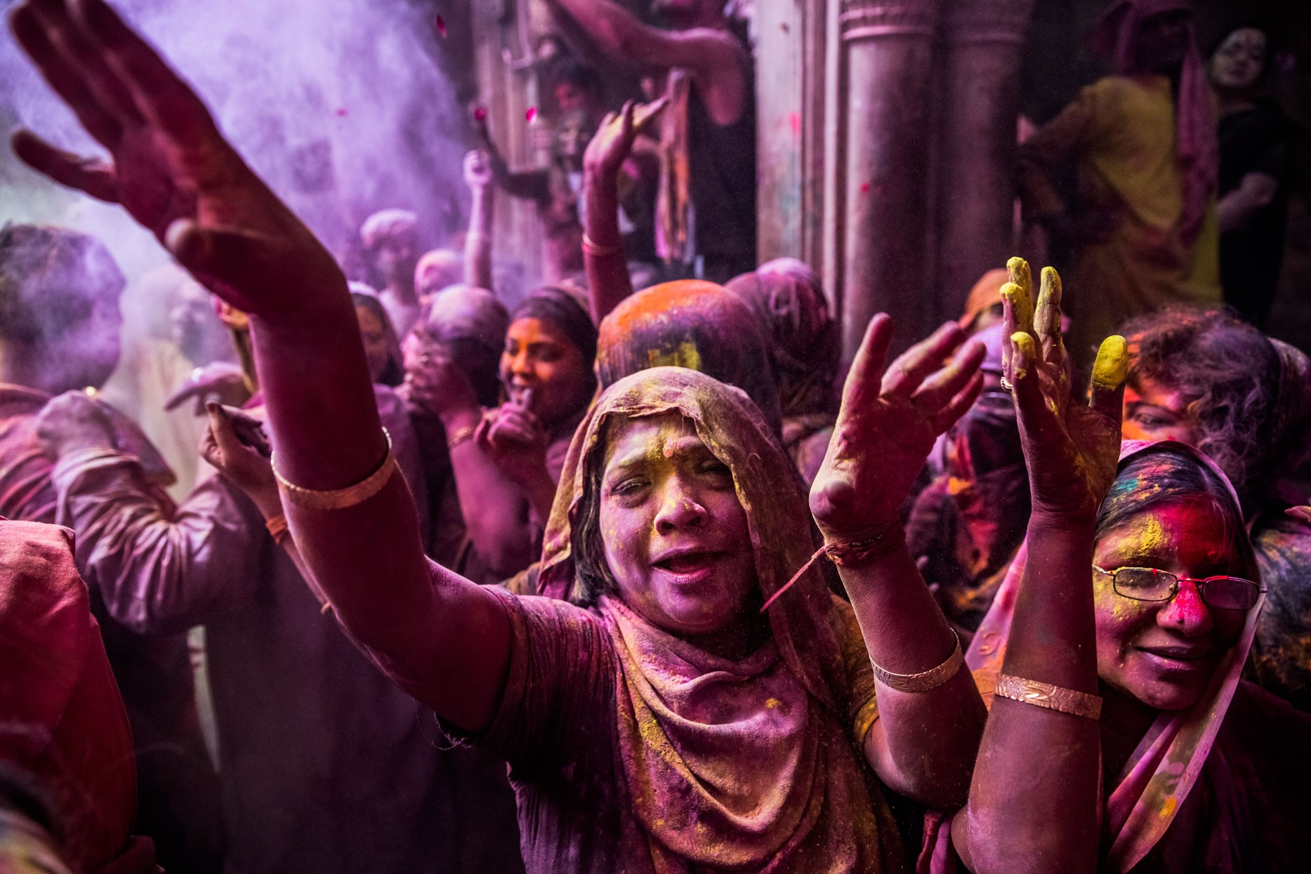 Hindu devotees play with colour during Holi celebrations at the Banke Bihari temple on March 27